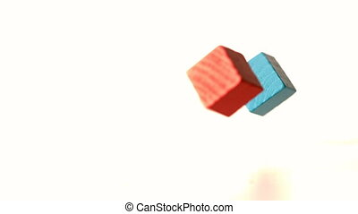 Building blocks falling and bouncing in slow motion