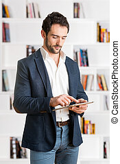 Casual Businessman Looking at a Tablet - Casual Businessman...