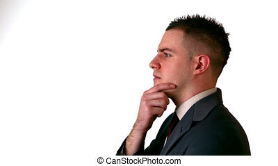 Businessman thinking with hand on chin in slow motion