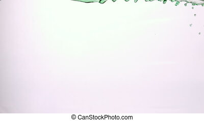 Green water splashing across white background