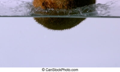 Kiwi fruit falling into water - Kiwi fruit falling into...