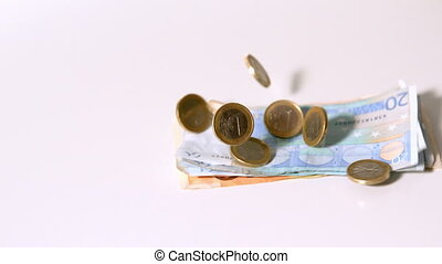 Euro coins and notes falling in slow motion