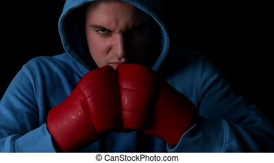 Tough boxer punching fists togethe - Tough boxer punching...