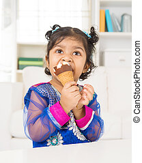Eating ice cream at home. - Eating ice cream. Indian Asian...