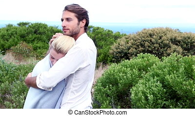 Young couple hugging by the sea