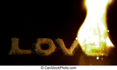 Fire burning up the word love on b - Fire burning up the...