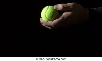 Tennis serve against black background in slow motion