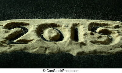 2015 spelled out in sand blowing a - 2015 spelled out in...