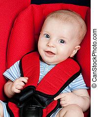 Happy boy in car seat
