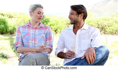 Young couple drinking white wine to