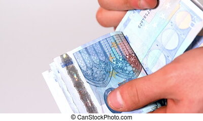 Hand counting wad of twenty euro notes in slow motion