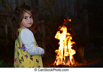 Little girl celebrate Lag BaOmer Jewish Holiday by lit a...
