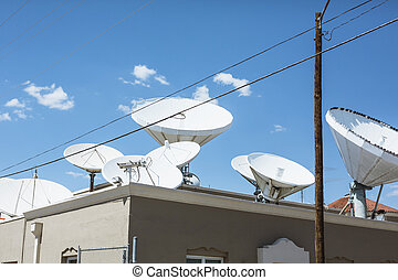 Sattelite dishes on a roof of a building in El Paso, Texas
