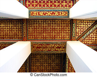Thai art decorative ceiling at the temple of Thailand
