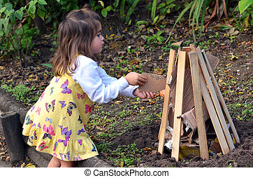 Little girl celebrate Lag BaOmer Jewish Holiday by preparing...