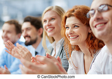 Applause - Photo of happy business people applauding at...
