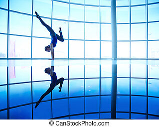 Standing on arms - Image of young female doing balance and...