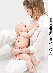 Breast feeding. - Little baby breast feeding.
