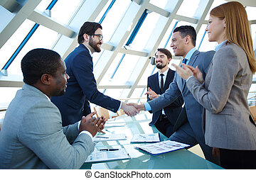 Right decision - Group of business people congratulating...