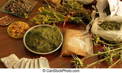 dried herbs at table in home ready for brews