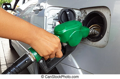 Woman hand refilling the car with fuel