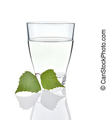 Birch sap on white background. - Birch sap in a glass and...
