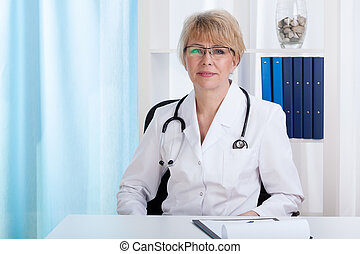 Middle aged female doctor - Portrait of a middle aged female...