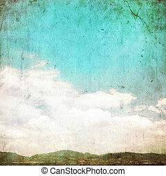 Clouds in summer blue sky - vintage edit.