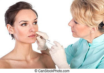 Cosmetic botox injection in the female face - Middle aged...