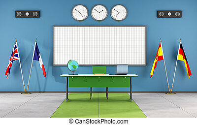 Classroom of a language school with teacher's desk and flags...