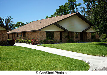 florida duplex with beautiful lawn - A new florida duplex...