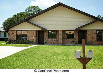 new florida duplex hoome with mailboxes - Straight on view...