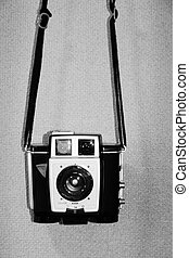 Vintage camera on texture background B&W