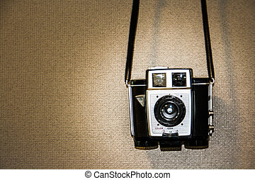 Vintage camera on texture brown  background