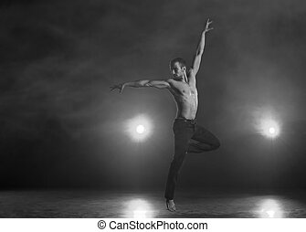 Contemporary Dance - Young and muscular man performing a...