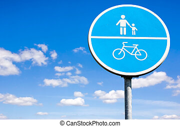 Bicycle and pedestrian shared route sign on the sky...
