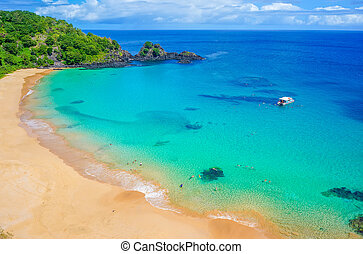 Beach in Brazil with a colorful sea