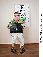 Funny manwearing spectacles in an office at the doctor -...