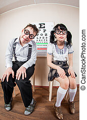 Two person wearing spectacles in an office at the doctor -...