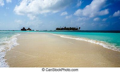Sandbank in the caribbean - Green valley with high mountains