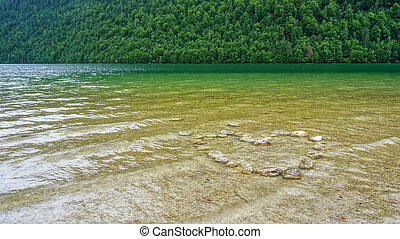 heart made of stones in a lake - heart made of stones in a...