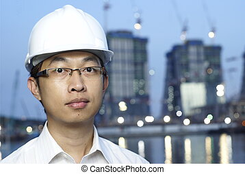 Asian construction engineer at worksite