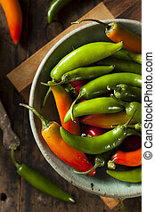 Organic Green Spicy Serrano Peppers on a Background