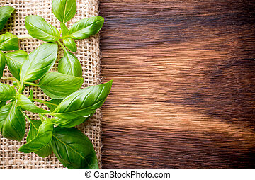Basil - Bunch fresh basil on a wooden background Aromatic...