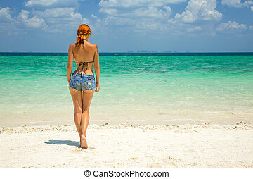 Beautiful redhead woman on the tropical beach with turquoise...