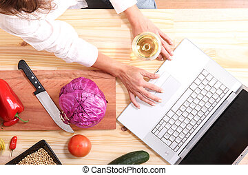 Internet Cooking - A beautiful mature woman cutting in the...