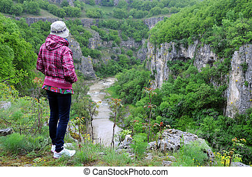 Woman on the Edge of the Cliff