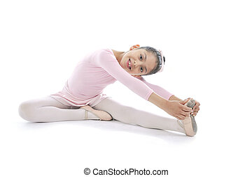 young cute Ballerina girl stretching wearing pink Ballet...