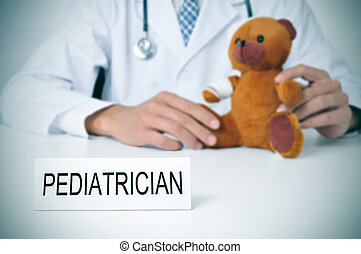 pediatrician - a doctor sitting in a desk with a injured...
