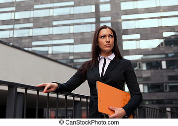 Beautiful business woman at modern building background